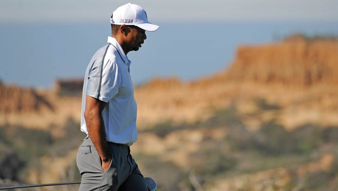 Feb. 5, 2015: Tiger Woods walks up the 13th during the first round of the Farmers Insurance Open golf tournament at Torrey Pines.