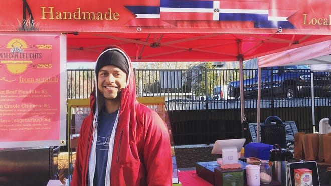 Michael in front of his empanada booth at the Lane County Farmers Market.