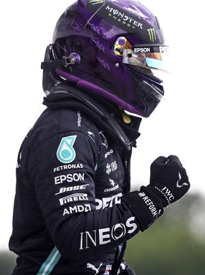 Mercedes driver Lewis Hamilton of Britain reacts after winning the qualifying for the Hungarian Formula One Grand Prix at the Hungaroring racetrack Saturday in Mogyorod, Hungary. The Hungarian F1 Grand Prix will be held on Sunday.