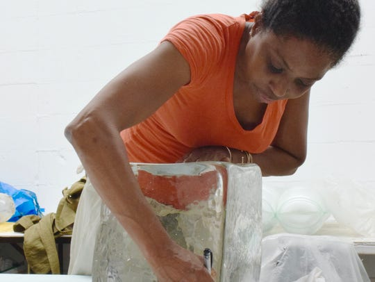 Artist Lorna Simpson works on a piece in the studio