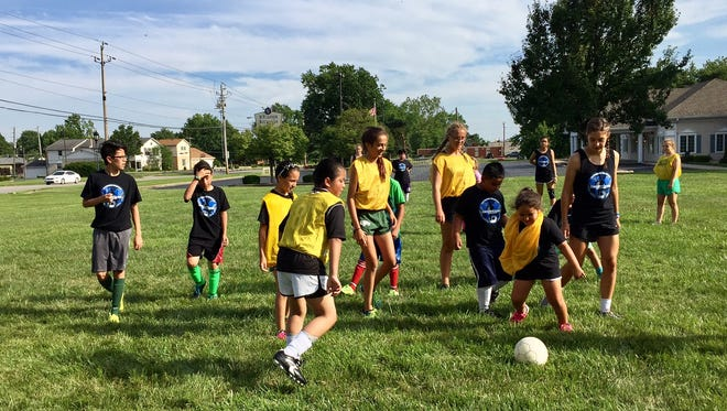 Members of the Zionsville High School girls soccer team spent last week teaching Speedway-area kids soccer skills and practicing their Spanish.