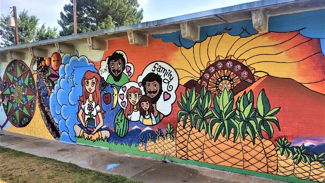 The walls of a covered patio structure at Vinewood Park are now full of vibrant motifs, thanks to a partnership involving the city, local artists, and concerned young community members.