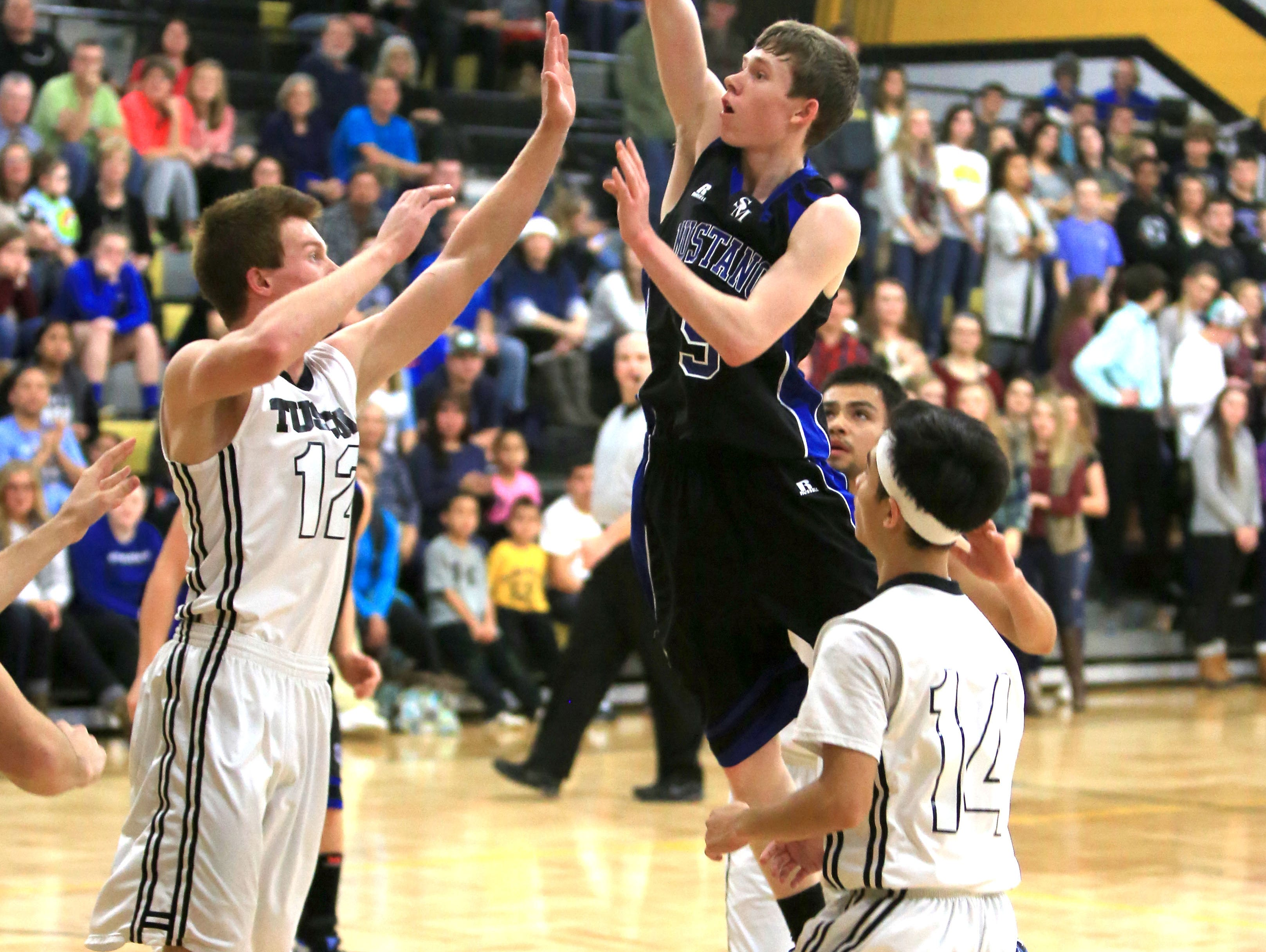 Tommy Brennan (5) scored a gam-high 28 points for the Smoky Mountain boys on Friday.