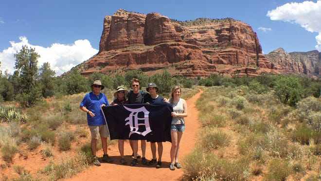 From left, Jim and Colleen Beauchamp of Macomb Township, Brendan Beauchamp of Allendale, Jeremy Balicki, a foreign exchange student from Buxtehude, Germany and Kate Beauchamp of Macomb Township. The Beauchamps are a family with Jim and Colleen the parents and Brendan and Kate the kids. While on a hike in the Coconino National Forest just outside of Sedona, AZ on July 18, 2017 at 2:46 pm, the temperature was a 110 degrees. In the background is Courthouse Butte.