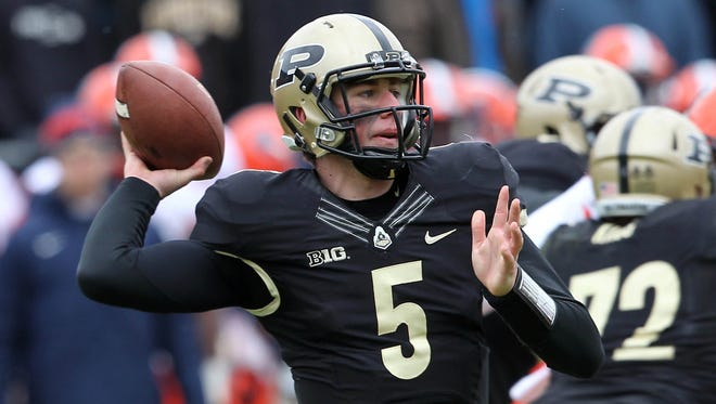 Nov 23, 2013; West Lafayette, IN, USA;  Purdue Boilermakers quarterback Danny Etling (5) passes the ball during the third quarter against the Illinois Fighting Illini at Ross Ade Stadium. Illinois won 20-16. Mandatory Credit: Pat Lovell-USA TODAY Sports