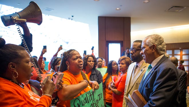 Parents and grandparents from Memphis Lift speak to Hilary Shelton, the Director to the NAACPÕs Washington Bureau and Senior Vice President for Advocacy and Policy, during the national NAACP board meeting Saturday, October 15, 2016 at the Westin Hotel in Downtown Cincinnati. The board of the civil rights organization is deciding to call for a moratorium on charter school expansion and the strengthening of oversight in how charter schools are operated.