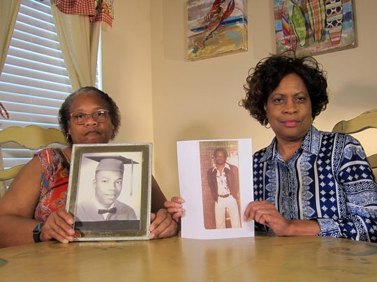 Mylinda Byrd Washington, 66, left, and Louvon Byrd Harris, 61, hold photographs of their brother James Byrd Jr. in Houston. James Byrd Jr. was the victim of what is considered to be one of the most gruesome hate crime murders in recent Texas history.