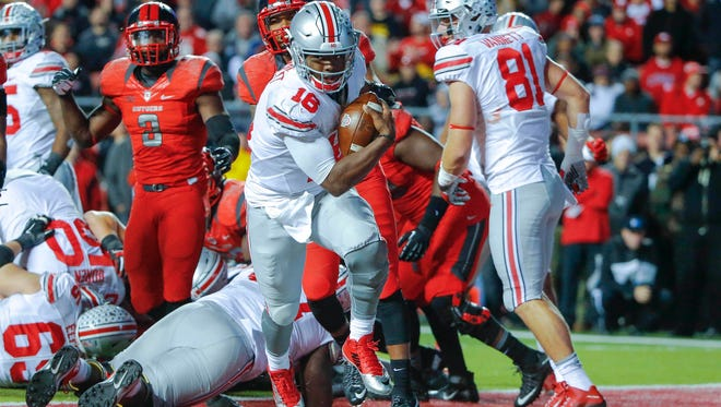 Ohio State Buckeyes quarterback J.T. Barrett (16) crosses the goal line for a second-quarter touchdown against the Rutgers Scarlet Knights at High Points Solutions Stadium.