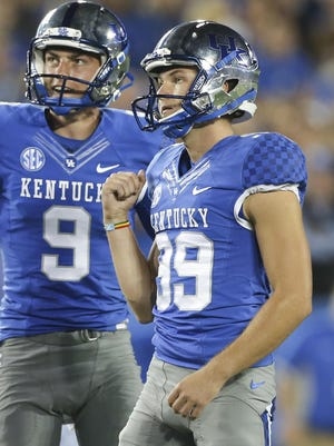 Kentucky kicker Austin MacGinnis, right, celebrates with punter Landon Foster after making a field goal during the second half of an NCAA football game against Florida, Saturday, Sept. 19, 2015, in Lexington, Ky. Florida won the game 14-9. (AP Photo/David Stephenson)
