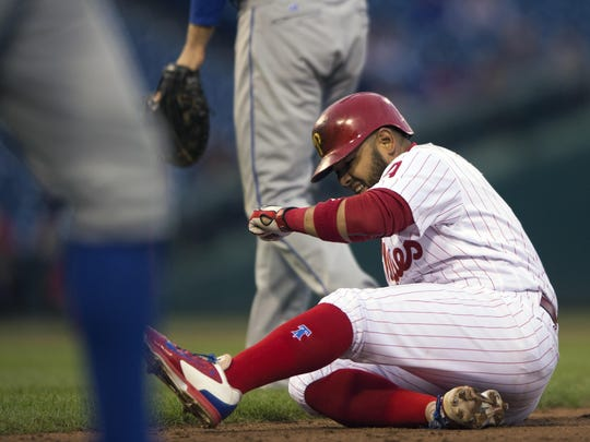 Phillies' Andres Blanco is tagged out in a rundown against the New York Mets on Tuesday. The Phillies lost 11-1.