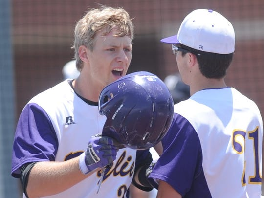 Wylie's Caleb Munton celebrates with Gatlin Martin, right, after hitting a two-run home run in the first inning against Iowa Park. It made the score 10-2 Iowa Park, which went on to win the game 18-7 to tie the Region I-4A quarterfinal playoff series Saturday, May 19, 2018 at Bulldog Field. Iowa Park won Game 3 8-2 to win the series.