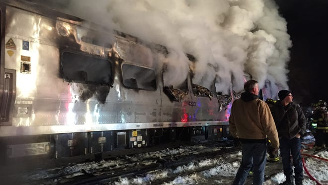 A Metro-North train burns after striking a sport-utility vehicle Feb 3 just north of Commerce Street in Valhalla