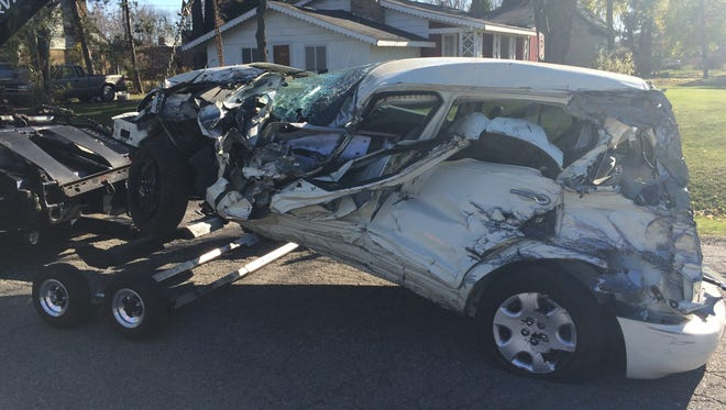 A woman who was driving this vehicle leaped to safety just before it was pushed into the path of an on-coming train on Hagadorn Road in Meridian Township on Monday. She was struck from behind as part of a chain-reaction accident.