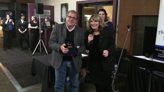 John Colone receives the Distinguished Service Award for Excellence from Greater Brighton Area Chamber of Commerce President and CEO Pam McConeghy.