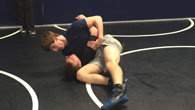 Granville junior Mathieu Holt drills with freshman Jaxtin Steffeny during practice Monday. Holt is competing in the Division II state tournament this week at 182 pounds.