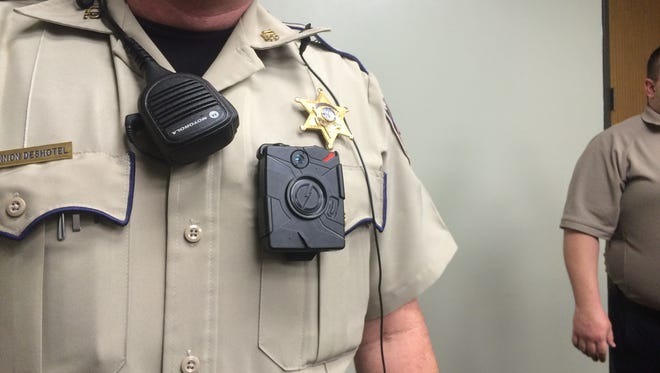 Patrol Deputy Shannon Deshotel shows off the Taser Axon body-mounted camera, which LPSO deputies will wear at all times while on patrol.