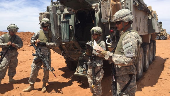 Soldiers from 40th Engineer Battalion brief each other about a convoy mission during the Network Integration Evaluation last spring.