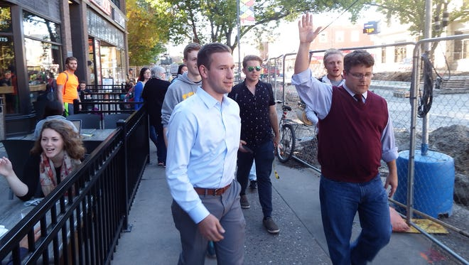 """""""Lord of the Rings"""" and """"Rudy"""" actor Sean Astin, right, leads people from The Java House to the Iowa City Public Library so they could take part in early voting on Sept. 29, 2016, in Iowa City."""