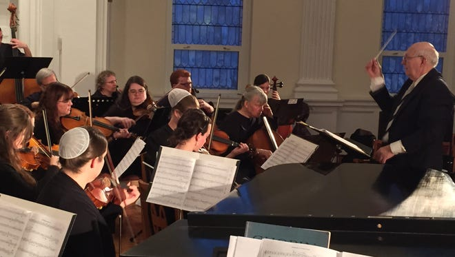 Conductor Herm Hopple directs the CVSM String Orchestra at Thomson Chapel on the Wilson College Campus.
