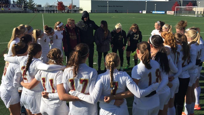 Arlington girls soccer huddles before its state Class AA semifinal against Clarence High School on Nov. 12, 2016.