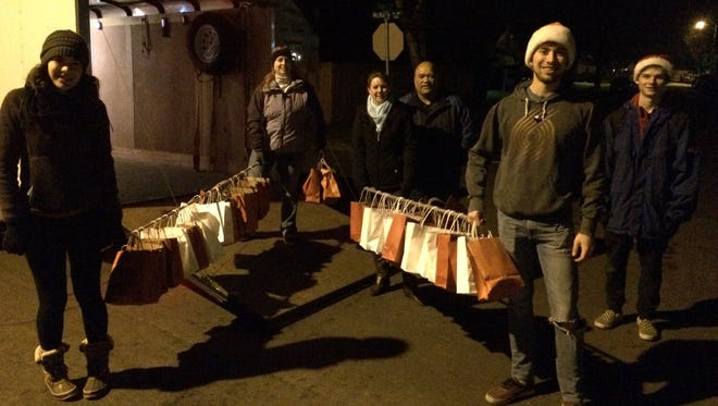 Volunteers for Operation Sneaky Elf deliver bags full of homemade cookies to nearly 1,400 homes early Christmas morning.