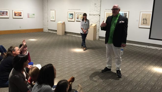 Children's author/illustrator William Joyce speaks to a crowd of children and adults at the National Center for Children's Illustrated Literature on Saturday