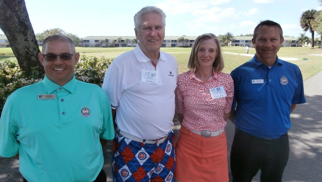 (From left) Scott Kash, assistant golf pro at Spring Run Golf Club; John and Patty Fitzgerald, Spring Run Charity Classic co-chairs and members of the Spring Run Charitable Foundation; and Spring Run head pro Jeff Carter gather during the Spring Run Charity Classic's golf tournament.