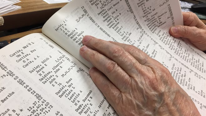Betty Winn, volunteer at the Oregon State Archives, scans a book of marriage records on Wednesday, June 14, 2017.