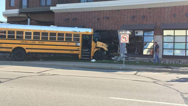 A bus crashed into the Stadium District Building at the intersection of Michigan Avenue and Cedar Street Tuesday, Sept. 26, 2017.