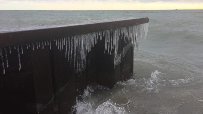 Icicles coat the side of a break wall at Conger Beach in Port Huron.
