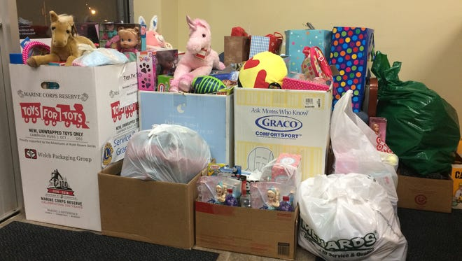 Community members donated a record number of gifts for Toys for Tots at the Daily Tribune office in 2016.