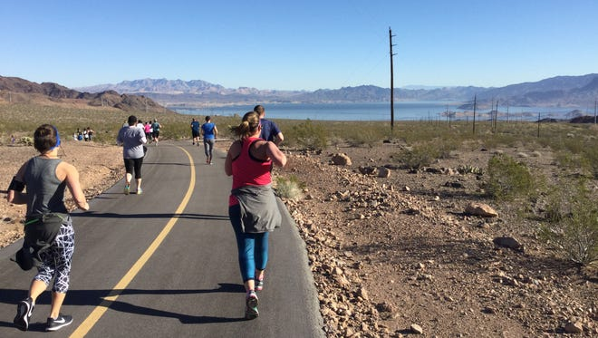 Runners race in the Saints and Sinners half marathon and team relay in February in Boulder City, Nevada.