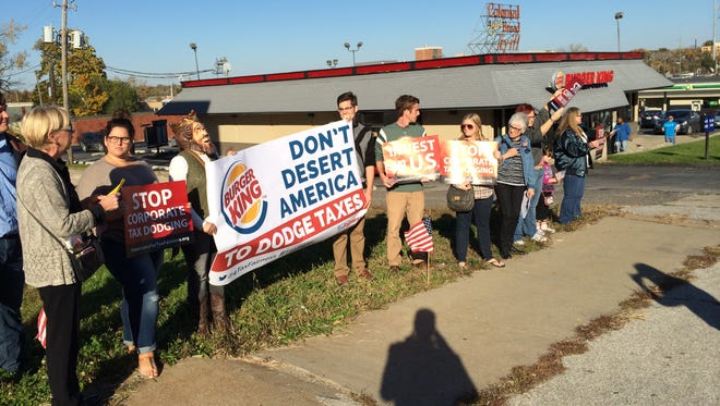 A group of Iowans protest Burger King's corporate inversion plan outside of a Des Moines restaurant Tuesday, Oct. 21, 2014.