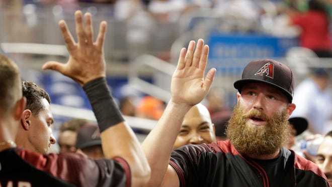 Arizona Diamondbacks relief pitcher Archie Bradley is high-fiver after pitching during the eighth inning of a baseball game against the Miami Marlins, Thursday, June 1, 2017, in Miami.