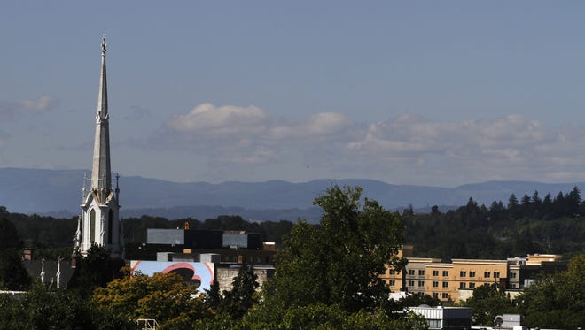 United Methodist Church and downtown Salem are seen from the roof of the Oregon Department of Transportation Building.
