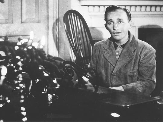 "Bing Crosby sings ""White Christmas"" in the 1942 musical ""Holiday Inn."""