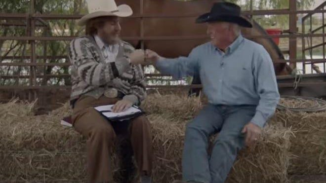 """Actor and comedian Sacha Baron Cohen fist-bumps with Texas Agriculture Commissioner Sid Miller in """"Borat 2."""""""