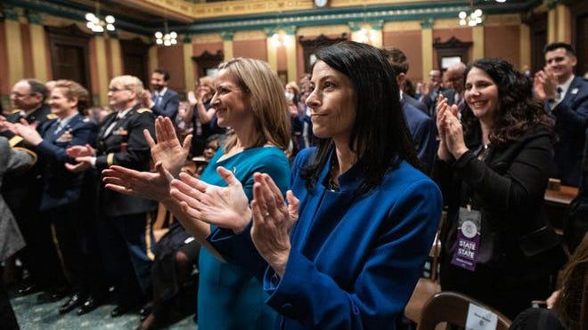 Attorney General Dana Nessel, center, Secretary of State Jocelyn Benson, center left, applauses for Governor Gretchen Whitmer during the State of the State address at the State Capitol in Lansing, Wednesday, Jan. 29, 2020.