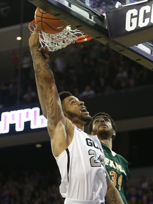 GCU's Keonta Vernon (24) tries to make a reverse layup against FAMU's Isaiah Martin (34) during the first half on Nov. 10, 2017 Grand Canyon University in Phoenix, Ariz.