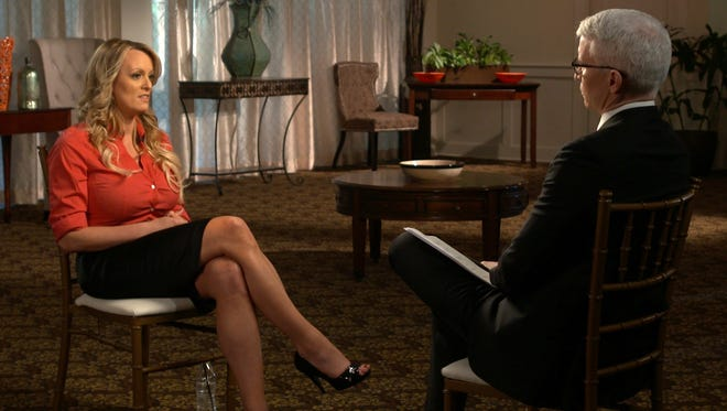 "This image released by CBS News shows Stormy Daniels during an interview with Anderson Cooper that will air on Sunday, March 25, on ""60 Minutes."""