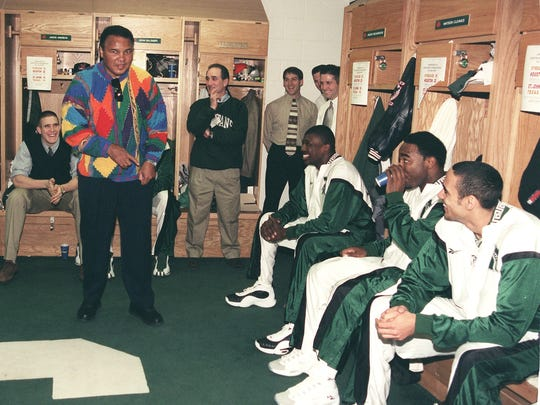 Muhammad Ali speaks to the Spartans in their locker room before their game with the Connecticut Huskies. Ali lightened the pre-game tension by telling jokes to the players.
