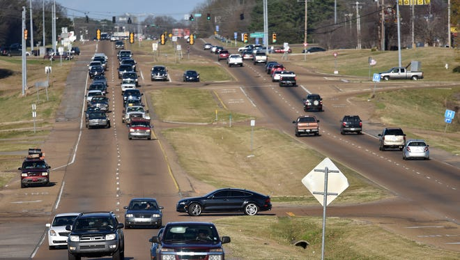 Motorists drive down the Highway 18 corridor Saturday that Jackson leaders have tapped as a potential source of revitalization for the city.