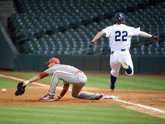 Alex Pinero stretches to catch the second out of a