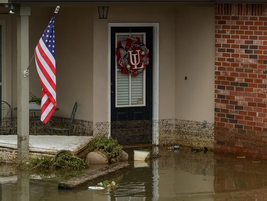 Flood damaged homes in Highland Ridge Subdivision in