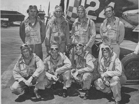Harold DeMoss, lower left, is seen with fellow pilots in 1945.