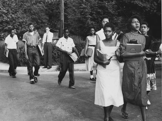 Ten of the 12 black students attending Clinton High School walk from their nearby homes to classes on Sept. 5, 1956. Among the students are, from left, Bobby Cain (stripped shirt), Maurice Soles, Alvah McSwain, Gail Epps (partly obscured), Regina Turner, Minnie Ann Dickey, and Jo Ann Allen.