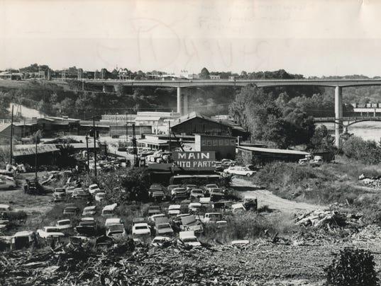 Main-Auto-parts-junkyard-w-river-behind-771009-Bill-Sanders-jpeg.JPG