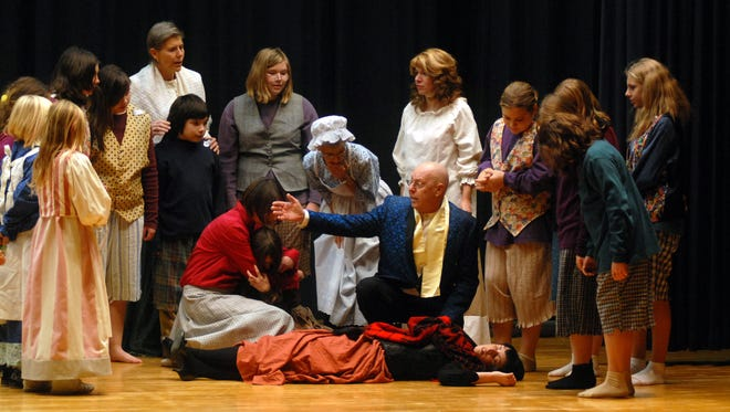 Members of the Algonac Community Theatre rehearse a for a past production.