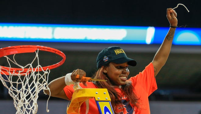 Syracuse's Alexis Peterson (1), cuts the net.