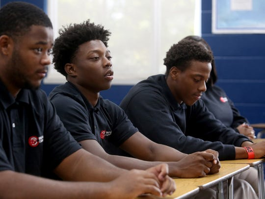 Tanell McCalebb, 17, of Detroit talks about growing up in the city as Jordan Davis, 17, and Ervin Butler, 17, listen.